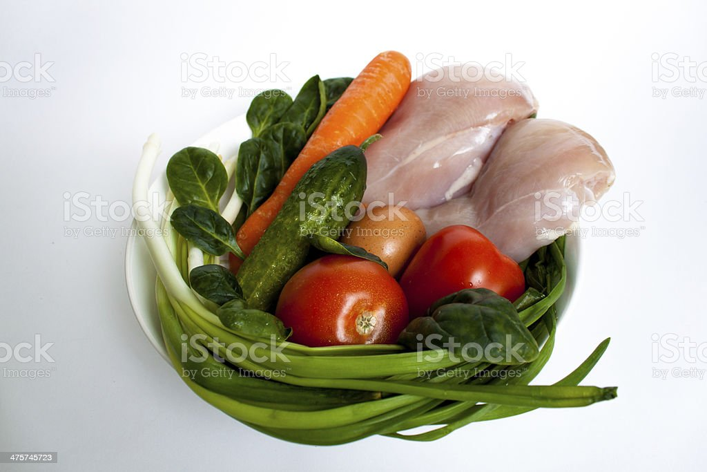 Raw meat and vegetables stock photo