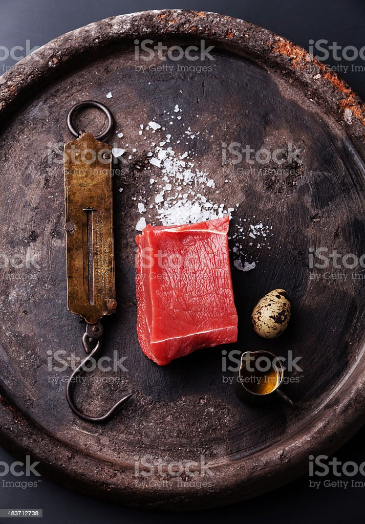 Raw meat and vintage steelyard Ingredients for cooking Steak Tartare stock photo