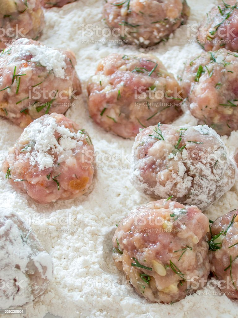 raw meat balls in flour ready to be fried royalty-free stock photo
