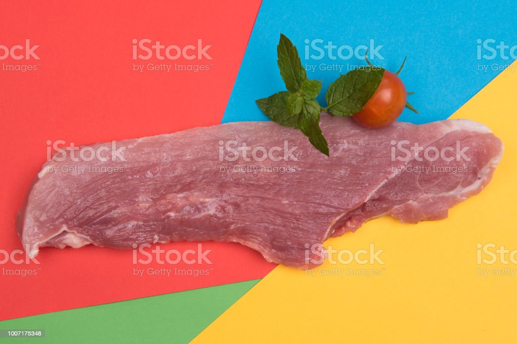 raw meat on colorful backgrounds stock photo