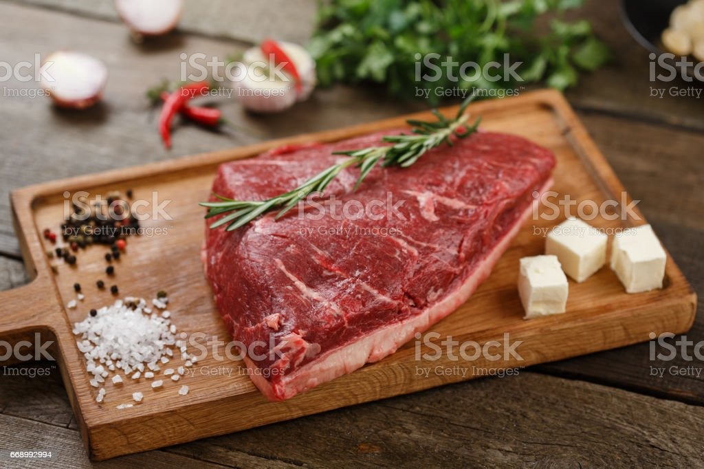 Raw meat on the wood stock photo