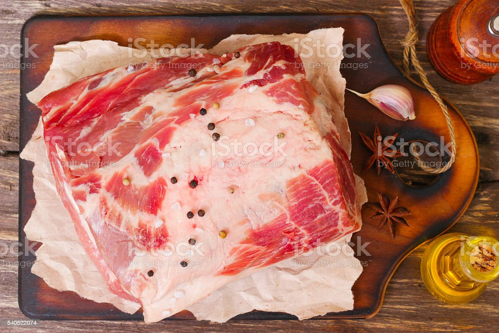 Raw meat. Pork neck with salt and spices stock photo