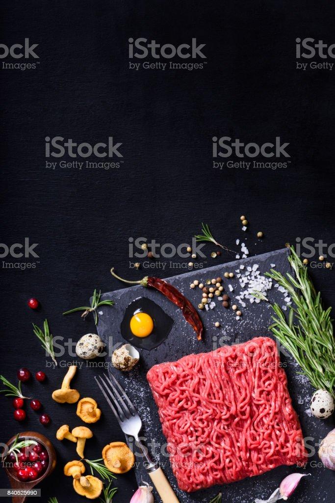 Raw meat. Raw beef steak minced rosemary and spices. stock photo