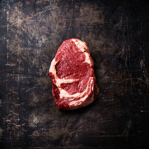 Raw meat Steak on dark background stock photo