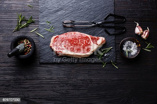 istock Raw meat Steak on wooden background copy space 629707030