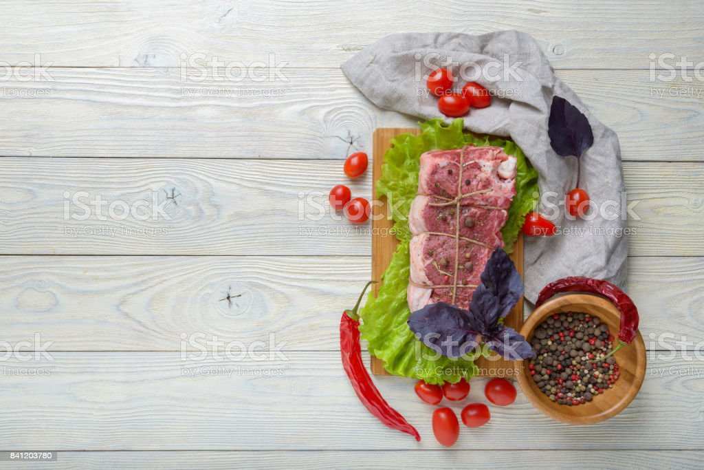 raw meat with ingredients on a wooden background stock photo