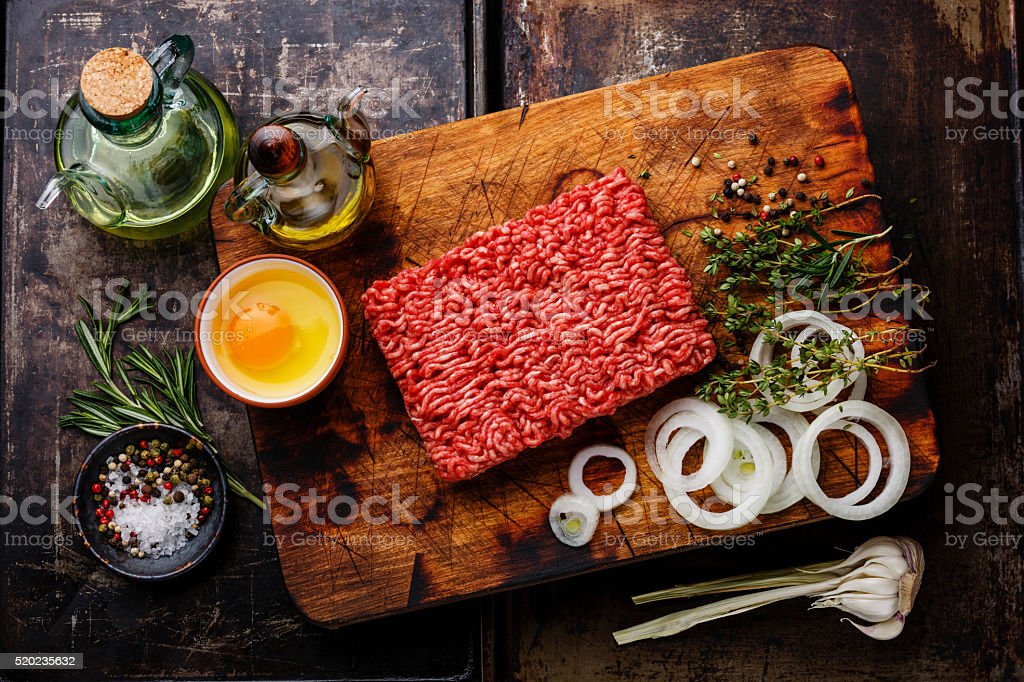 Raw Minced meat and condiments stock photo