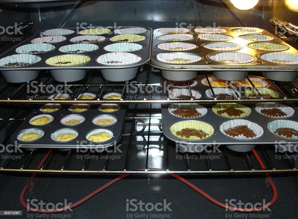 Raw Muffins in Oven royalty-free stock photo