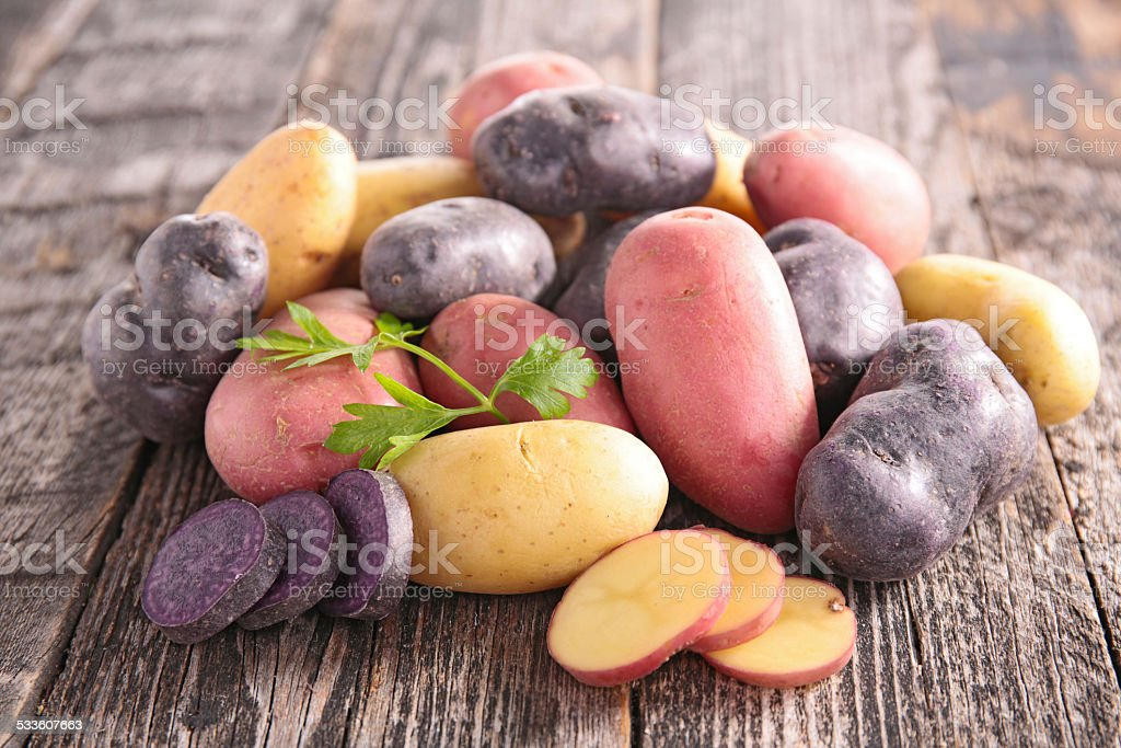 raw multicolored potato stock photo