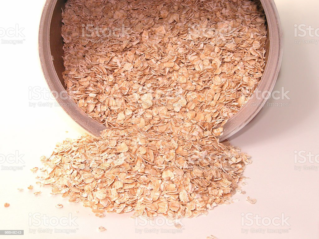 Raw Oats Spillin from Container royalty-free stock photo