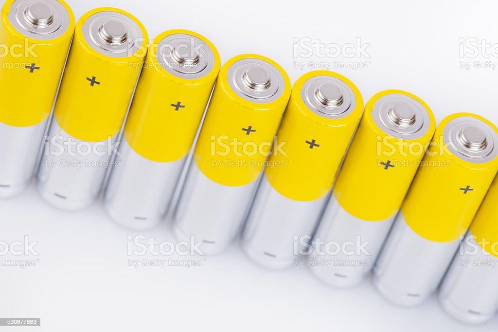 Raw of AA alkaline batteries stock photo