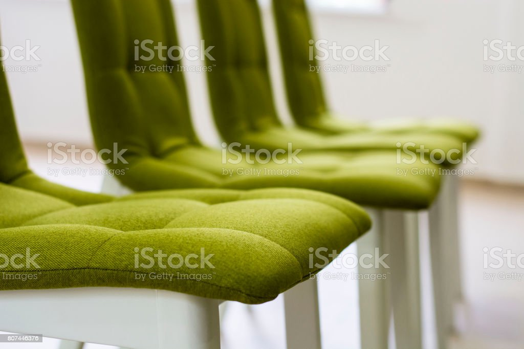 Raw of empty chairs in a conference hall stock photo