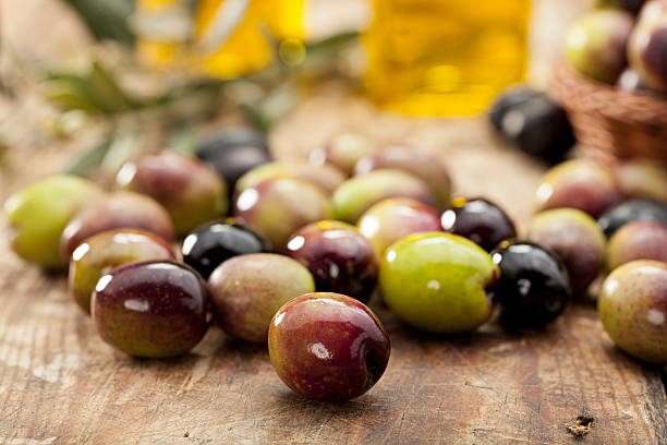 raw olives - olive oil stock photos and pictures
