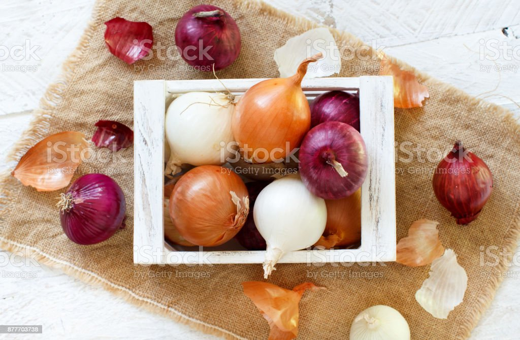 Raw onions in box stock photo