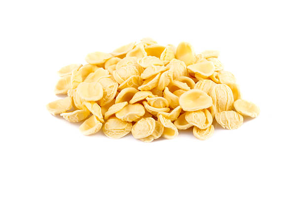 Raw Orecchiette Pasta Raw orecchiette pasta over white background. orecchiette stock pictures, royalty-free photos & images