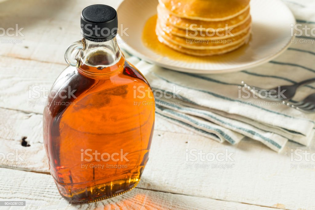 Raw Organic Amber Maple Syrup stock photo