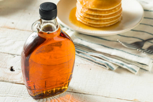 raw organic amber maple syrup - maple syrup stock photos and pictures