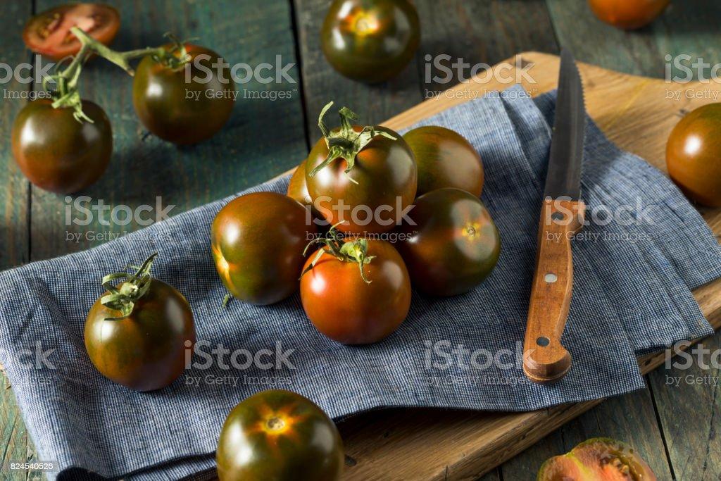 Raw Organic Brown Kumato Tomatoes stock photo