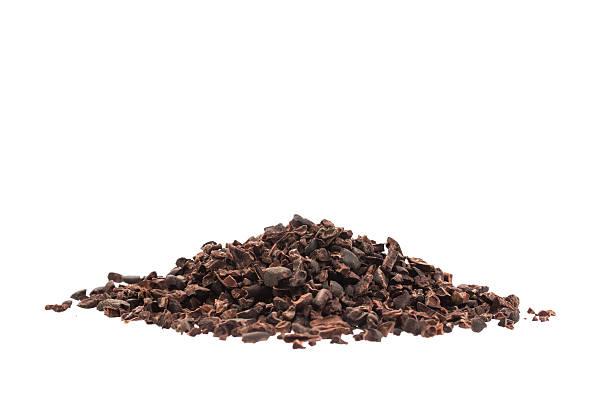 raw organic cacao nibs isolated on white - stålpenna bildbanksfoton och bilder