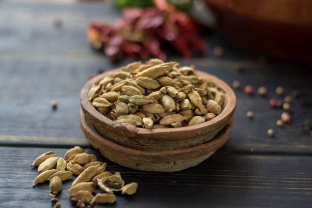 Raw Organic Cardamom Pods Ready to Use - ancient ayurveda medicine and spice Raw Organic Cardamom Pods Ready to Use - ancient ayurveda medicine and tasty spice cardamom stock pictures, royalty-free photos & images