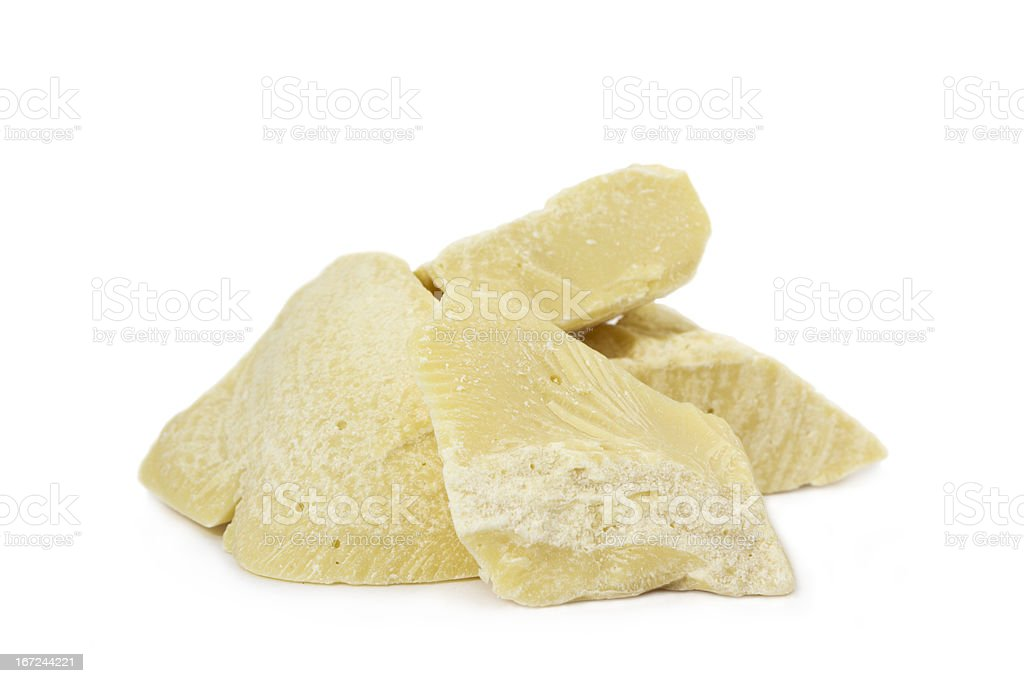 Raw organic cocoa butter on a white background stock photo