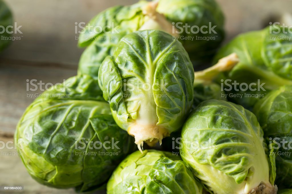 Raw Organic Green Brussel Sprouts stock photo