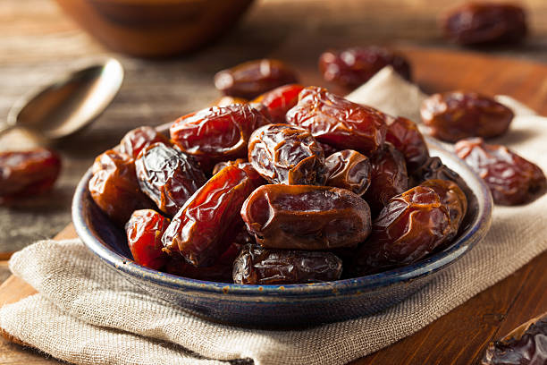 Raw Organic Medjool Dates Raw Organic Medjool Dates Ready to Eat date stock pictures, royalty-free photos & images