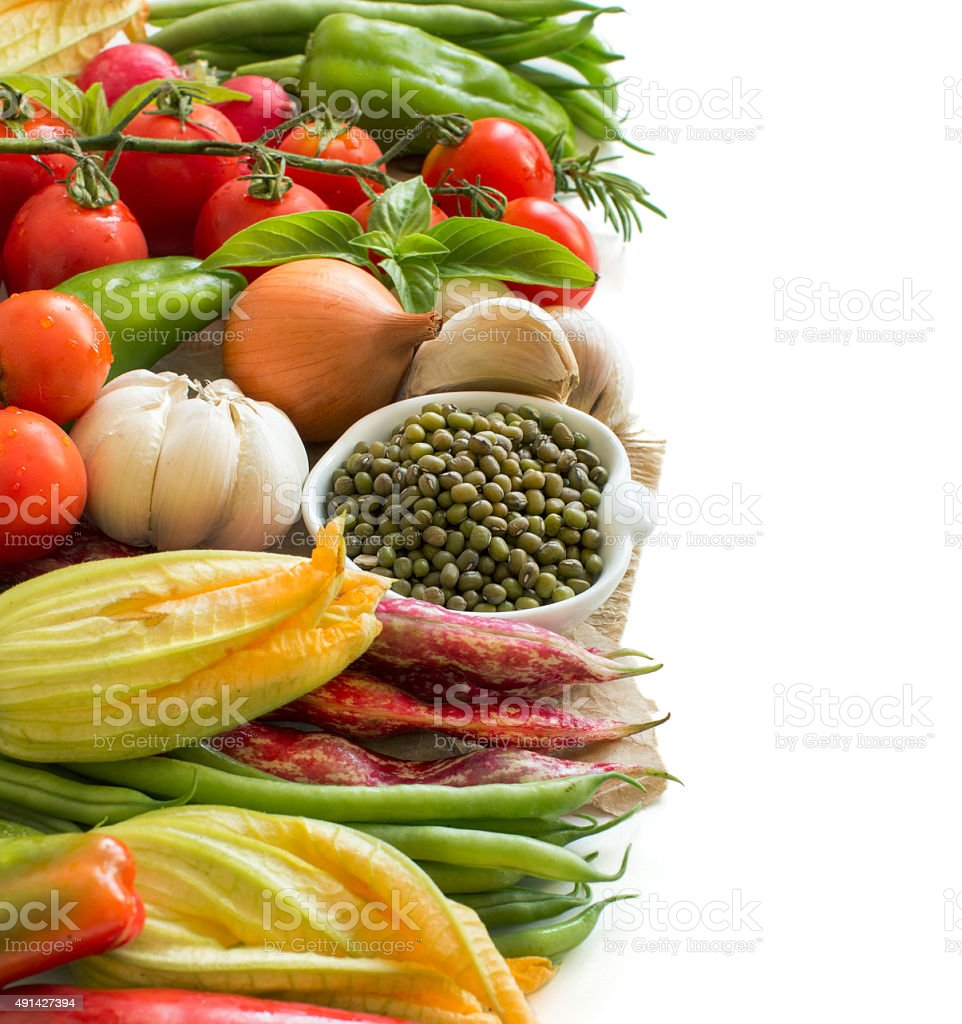 Raw organic mung beans in a bowl and vegetables stock photo