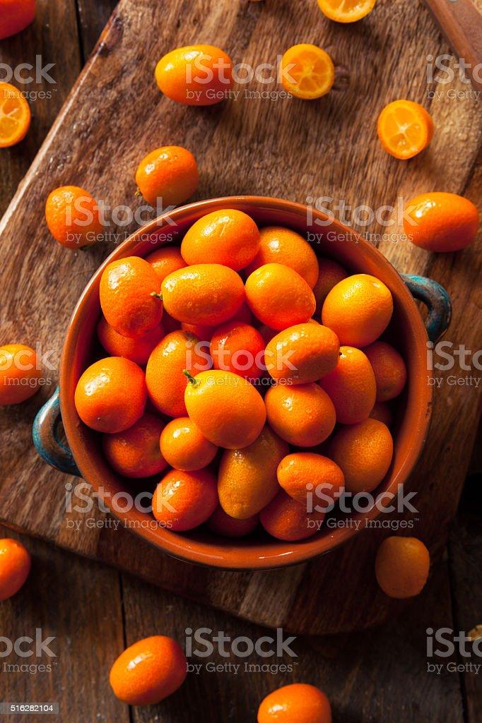 Raw Organic Orange Kumquats stock photo
