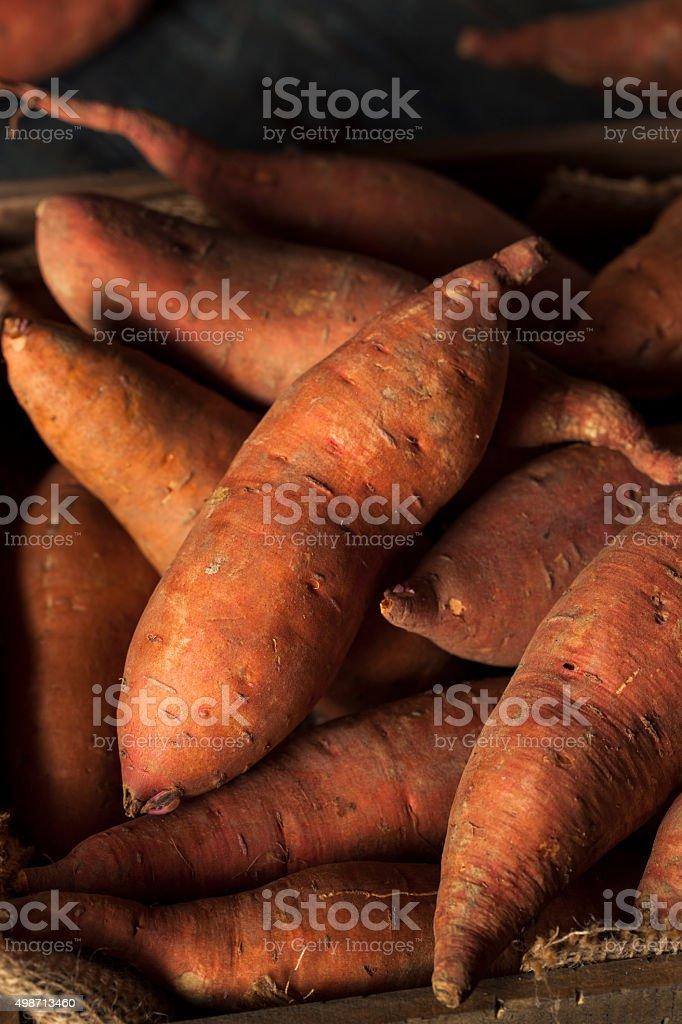 Raw Organic Sweet Potatoes stock photo