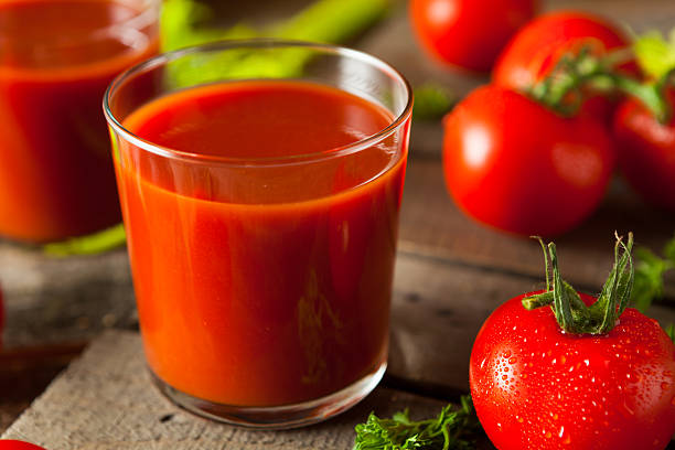 Raw Organic Tomato Juice Raw Organic Tomato Juice with Parsley and Celery vegetable juice stock pictures, royalty-free photos & images