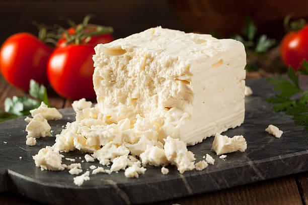 Raw Organic White Feta Cheese Raw Organic White Feta Cheese for Crumbling feta cheese stock pictures, royalty-free photos & images