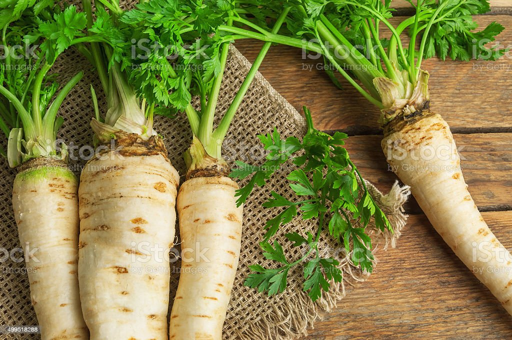 raw parsley roots on burlap napkin