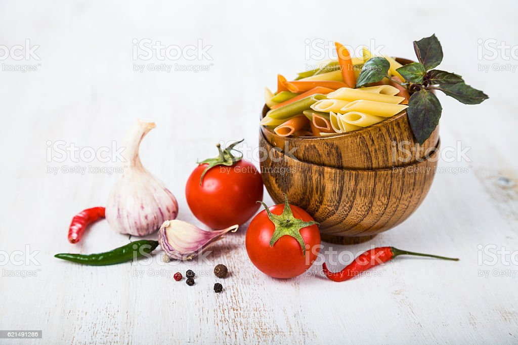 Raw pasta and spices in wooden bowls Lizenzfreies stock-foto