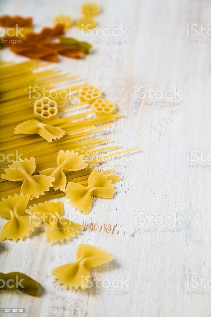 Raw pasta and spices on wooden background foto stock royalty-free
