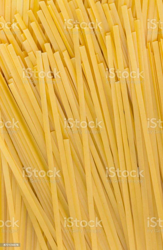 Raw pasta background close up stock photo