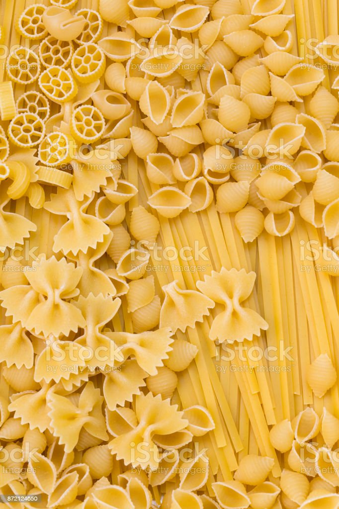 Raw pasta background close up stock photo