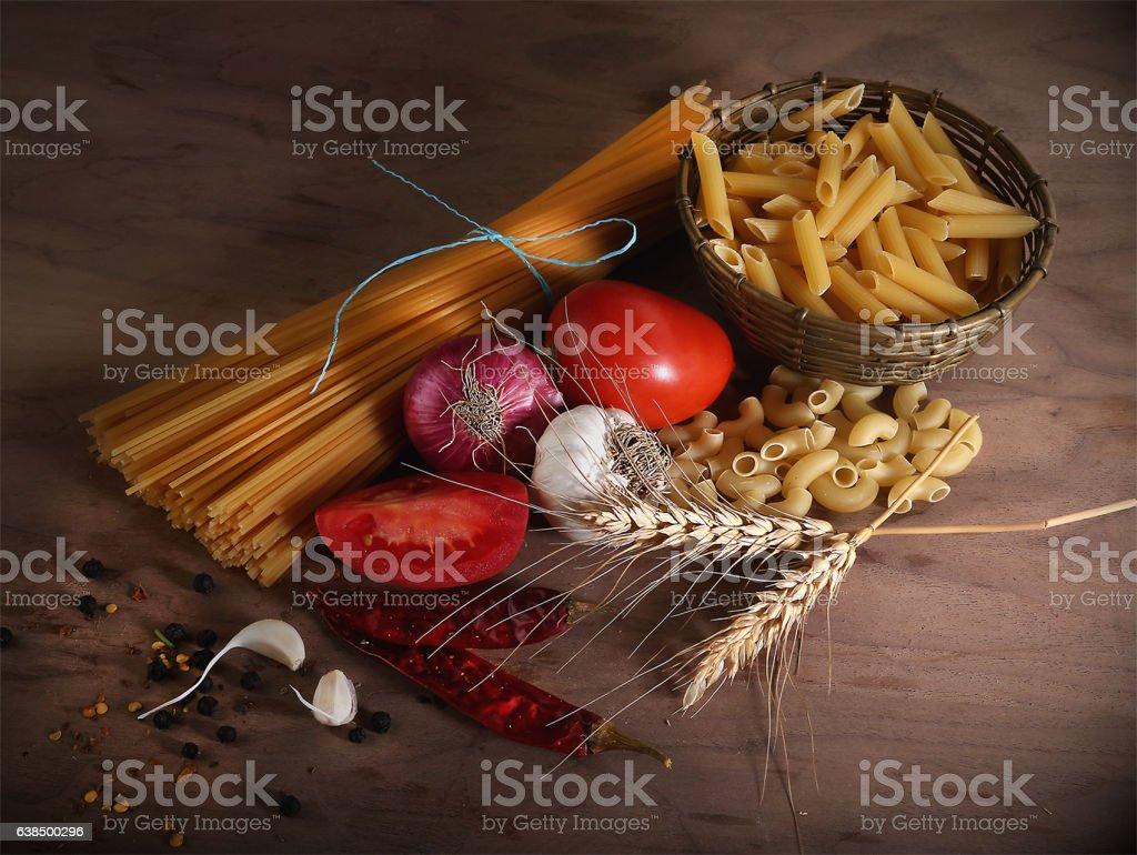 Raw Pasta italiana with Spices stock photo
