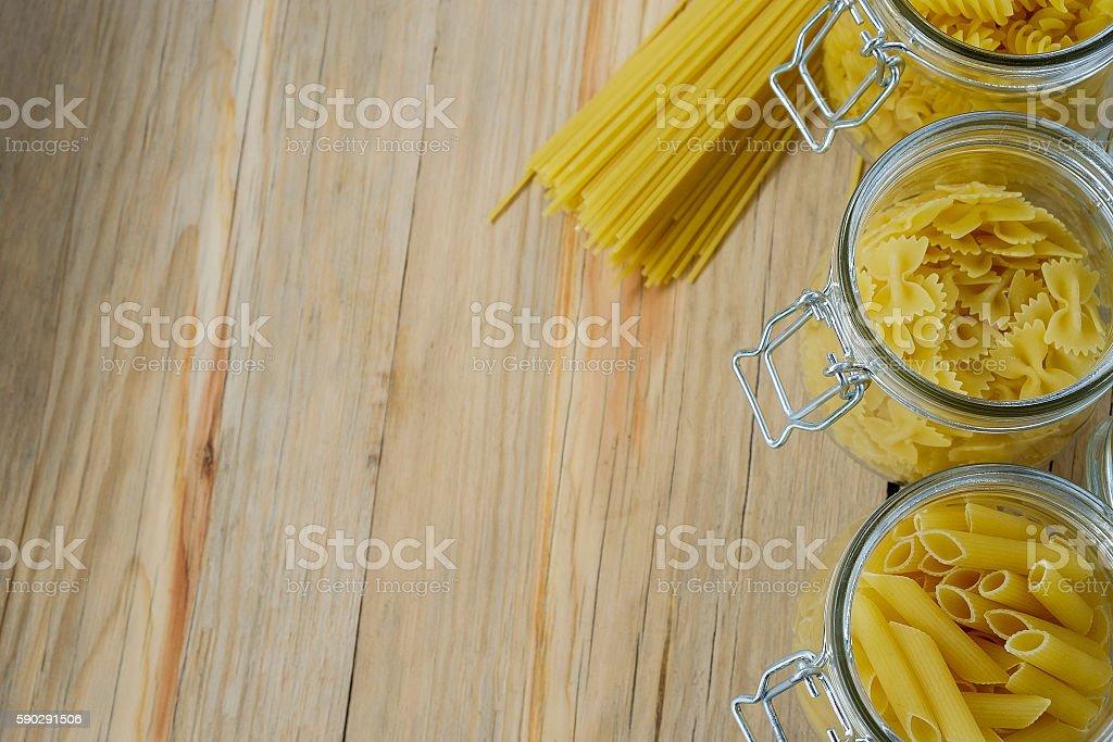 Raw pasta on wood background texture royaltyfri bildbanksbilder