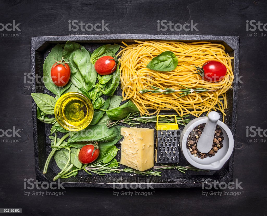 raw pasta  on wooden rustic background top view close up stock photo