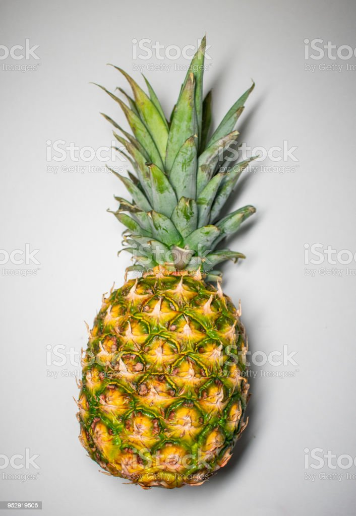 raw pineapple on white stock photo