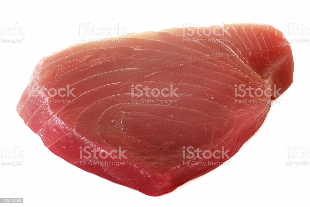 A raw pink fillet of tuna fish royalty-free stock photo