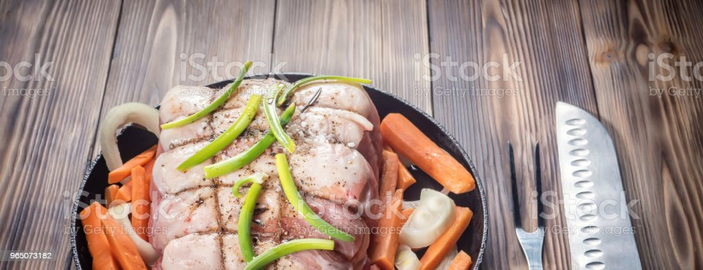 Raw pork chop marinated meat roll with assorted vegetables royalty-free stock photo