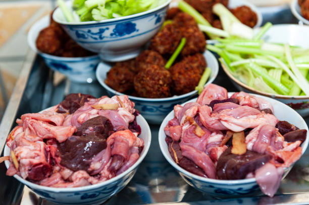 Raw pork food Raw pork food for hotpot in wedding dinning in Chinese village, Guilin, China. chinese wedding dinner stock pictures, royalty-free photos & images