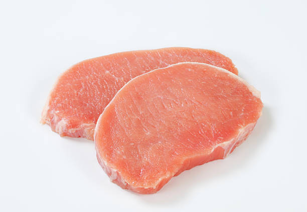 raw pork loin chops two raw boneless pork loin chops on a white background pork stock pictures, royalty-free photos & images
