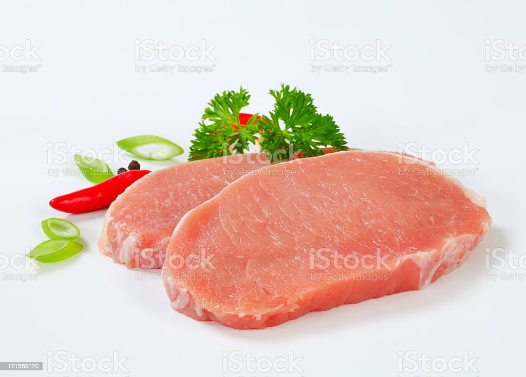 raw pork loin chops with spices royalty-free stock photo