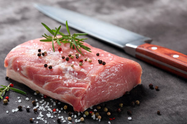 """Raw pork loin with spices Raw pork loin with spices""""n""""n pork stock pictures, royalty-free photos & images"""