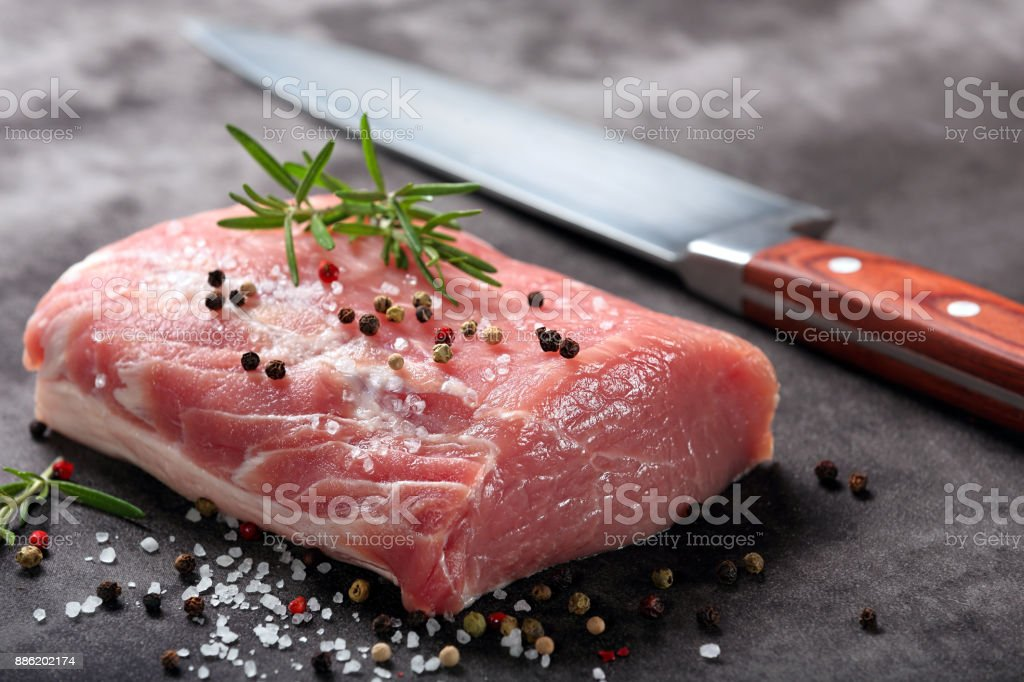 Raw pork loin with spices stock photo