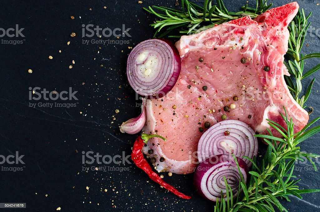 Raw pork meat with herbs and spices stock photo