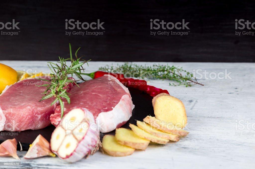 Raw pork meat with spice ingredient zbiór zdjęć royalty-free